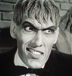 ___ lurch addams lurch face family lurch exaggerated smile family photo.jpg